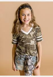 Little Girls Wearing A Green Camo Short Sleeve T Shirt With Buckle Denim Shorts