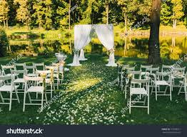 Decorative Wedding Arch Folding Chairs Near Stock Photo ...