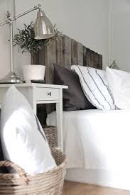 DIY Scandinavian Recycled Pallet Headboard Via Shelterness