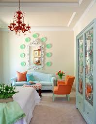 burnt orange paint color bedroom eclectic with blue throw pillow