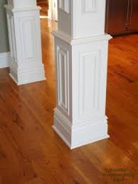 nice column molding idea for covering up basement support beams