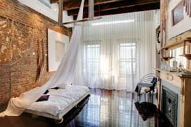 Modern Brick Wall Bedroom Loft Style With High Ceiling Wooden Beams And Low Slung Decor
