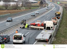 100 Tow Truck Accident Workers Cleaning Wreckage From Traffic On Highway