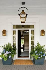 front door with lantern and wall sconces outdoor sconces can