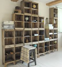 build a shelving unit with a wall of old crates diy home decor