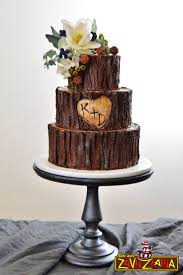Rustic Wedding Cake Decorated With Chocolate Ganache And Gum Paste Flowers