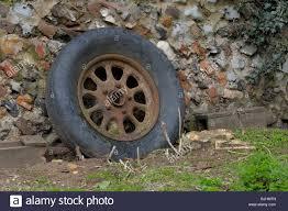 Old Farm Trailer Wheel In Farmyard