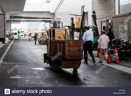 A Worker Drives A Turret Truck At The New Tokyo Metropolitan Central ... Raymond Very Narrow Aisle Swingreach Trucks Turret Truck Narrowaisle Forklifts Tsp Crown Equipment Forklift Reach Stand Up Turrettrucks Photo Page Everysckphoto The Worlds Best Photos Of Truck And Turret Flickr Hive Mind Making Uncharted 4 Lot 53 Yale Swing Youtube Hire Linde A Series 5022 Mandown Electric Transporting Fish By At Tsukiji Fish Market In Tokyo Worker Drives A The New Metropolitan Central Filejmsdf Truckasaka Seisakusho Left Rear View Maizuru