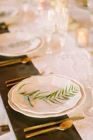 White Charger Plates Sprig Greenery Wood Table Faux Wedding Party Styled Shoot Rustic Event Gold