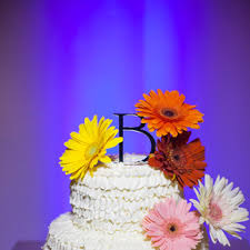 Ruffled Buttercream Cake With Colorful Daisies