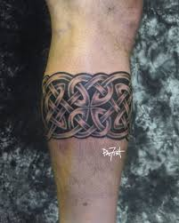 Black Ink Celtic Band Tattoo On Leg