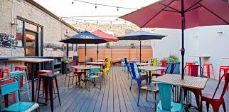 Elegant Wicker Park Restaurants With Patio Also Colorful Restaurant Chairs For Seating Rectangle Wooden Table Above Flooring Around Brick Wall