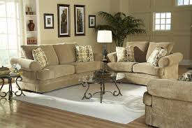 minimalist living room area with light brown suede living