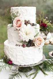 A Three Tiered Wedding Cake Decorated With White Dahlia Blush Roses Gold Dusted Berries And Greenery Created By Elise Cakes