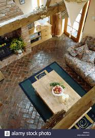 aerial view of pine table on herringbone pattern reclaimed brick