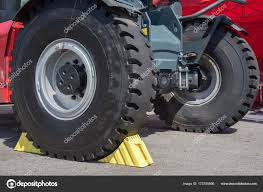 100 Big Truck Rims Yellow Wheel Chocks Under The Big Truck Wheels Stock Photo Vox19