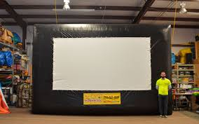 Inflatable Movie Screen - Covington, GA | Affordable Moonwalk Rentals Diy How To Build A Huge Backyard Movie Screen Cheap Youtube Outdoor Projector On Budget 6 Steps With Pictures Elite Screens Yard Master 200 Projection Screen Rent And Jen Joes Design Best Running With Scissors Diy Pics Charming Open Air Cinema 16 Feet Home For Movies Goods Projector Screens Theater Guide People Movie Theater Systems Fniture And Ideas Camp Chef Inch Portable Photo Watching Movies An Outdoor Is So Fun It Takes Bit Of