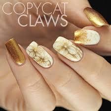 Nail Design Gold And White Stylish white and gold nail art