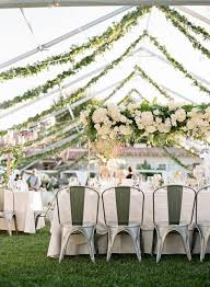 Outdoor wedding decor with cascading garland and florals