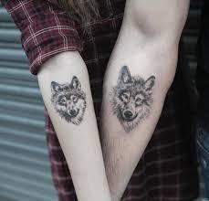 Male And Female Matching Wolf Tattoo