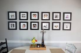 If Youre Looking For A Gallery Wall With Uniform Look Check Out This Lovely Display Featuring Two Neat Rows Of Photos In Black Frames