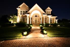 House And Driveway With Landscape Lighting