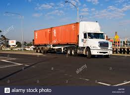 Transportation And Trucking / A Semi - Trailer Transporting A Stock ... Ltl Trucking Freight Shipping Toronto Ontario Logistic Shipping And Freight Transportation Business Animated Icons Truck On The Highway Transport Stock Services Ftl Get A Free Rate Quote Exfreight Van Package Delivery Transport Truck 13391286 Wittebroruckcompyandshippgexpertinthemidwestfull Investing In Transports Intermodal Part Of Is Road Rail Drayage Transportation Auto Banner With Container Vector Image Company Terminal Locations Ceo Insights Cargo Yard Photo Dissolve Logistics Icon With Commercial Isolated