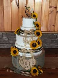 Four Tier Rustic Wedding Cake Almond Cream Icing Accented With Real Sunflowers Burlap And