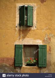 100 Ochre Home Green Shutters On Ochre Painted House Provence Stock Photo