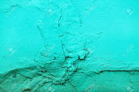 fragment of the wall painted bright turquoise paint cracked