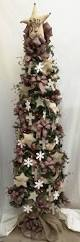 Downswept Pencil Christmas Tree by Get Into The Christmas Season With Our Unique Primitive Star