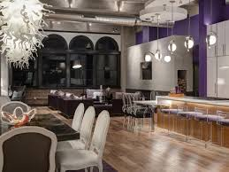 Contemporary Loft With Purple Accent Wall And Ghost Chairs