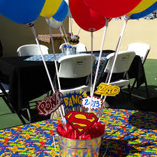 Graduation Table Decorations To Make by Right At Home Super Hero Graduation Party