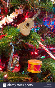 Musical Instrument Ornaments Hanging On Christmas Tree