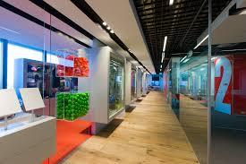 Epoxy Flooring Phoenix Arizona by Retail Showroom Using Hardwood Flooring And Bright Orange Epoxy