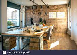 interior of industrial style coworking office stock photo