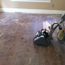 hardwood floor sander trying out a rental floor sander at the