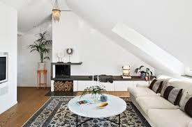 dachschraege ideen wohnzimmer offener kamin stauraum