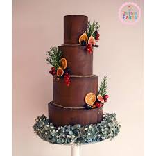 Chocolate Wedding Cake With Leaves And Fruit