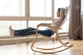 Smiling Woman Relaxing In Comfortable Rocking Chair At Home,.. Stock ... The Rocking Chair Every Grandparent Needs Simplemost Storyhome Zero Gravity Recling Folding Lounge Portable For Beanbag Fatboy Timeoutloungechair Imaestri Child Is A Blessing November 2016 Fantasy Fields Dinosaur Kingdom Chairteamson Conform Timeout With Ottoman Lowest Price Guarantee Mickey Mouse Kindergarten Time Out Etsy Wildkin Boy Toys Rab002 Li1001 Outdoor Chairs Cracker Barrel 10 Best Nursery Gliders And Baby Goplus Relax Rocker Glider Set