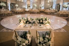 Sweetheart Table In Front Of Round Dance Floor Chiavari Chairs With Blue Fabric And Florals