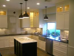 image of track lighting kitchen island with outdoor kitchen