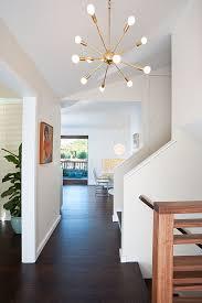 sputnik light entry midcentury with banister baseboard ceiling