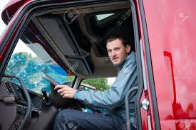 100 Truck Driver Pictures Happy Truck Driver Sitting In The Cab Of Red Truck Behind The