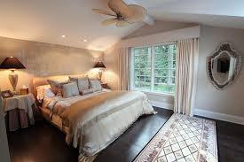 Dark Wood Flooring Design For Master Bedroom Decorating Ideas With Rectangular Carpet And Fan On Sloped Ceiling Also Using Wall Mirror