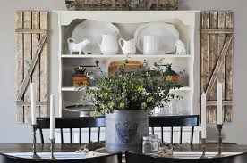 A Floral Centerpiece With An Old Farmhouse Backdrop Incredible Rustic Dining Room Ideas
