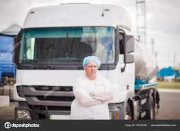 100 The Milk Truck Driver Of The Milk Truck Near The Truck Is Stock Photo