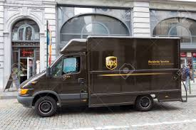100 Ups Truck BRUSSELS JULY 30 UPS Driver Delivers Packages On July