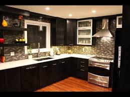 kitchen cabinets with light countertops and floors