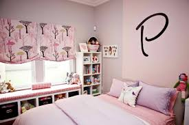 Kids Room Pink Bed With Purple Bedding Next To White Wooden Bay Windows